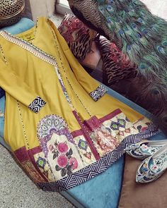 RESTOCKED on popular demand Mustard lawn angrakha cut kameez with beautifully composed digitally printed daaman border and embroidered monochrome borders. Stylish Dresses For Girls, Stylish Dress Designs, Simple Dresses, Casual Dresses, Pretty Dresses, Short Dresses, Casual Outfits, Simple Pakistani Dresses, Pakistani Dress Design