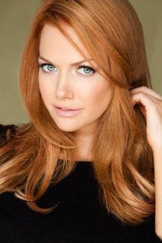 warm strawberry blonde with part in middle long layers. . Love.