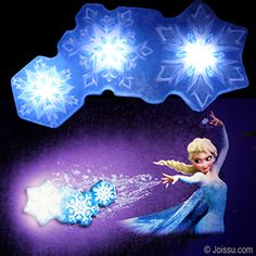 """DISNEY'S FROZEN SNOWFLAKE LIGHT DANCE. Just put the decal on your wall and hang this beautiful light at the tip of Elsa's fingers. Choose from the 5 light programs to suit your mood. 3 """"AA"""" batteries required - not included. Light has auto shut off so that you can use it as a night light. Each light set display boxed with a """"Try Me"""" button.  Size 15 X 13 Inch decal, 14 X 7.5 X 2 Inch light,"""