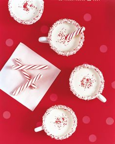 Kids will love this cooked, nonalcoholic eggnog flavored with peppermint and vanilla extracts. Cups are rimmed with melted white chocolate and crushed candy canes for a fun garnish.