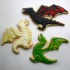 Daenerys' dragons, Drogon, Viserion, and Rhaegal done by Jesicakes.  For more Game of Thrones decorated cookies click through!