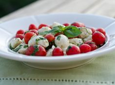 Marinated Mozzarella, Cherry Tomato, and Basil Salad. Made this for a dinner party to go with lasagna and it was a hit!