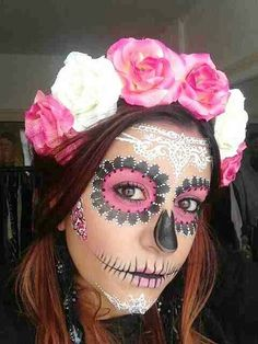 pink flowers on sugar skull makeup for halloween