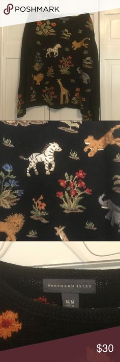Northern Isles Sweater size Med Northern Isles Black muilti color sweater .With Wild Animals on it.In very good used shape. Northern Isles Sweaters