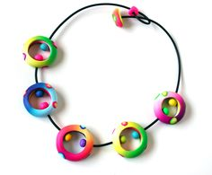 Check out this woman's shop for some of the loveliest and most interesting fimo-type clay jewelry I have seen