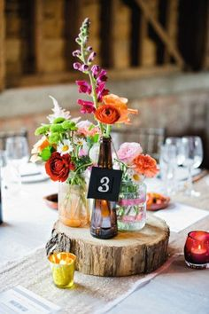 Display your wedding flowers in bottles and jars for added variation!