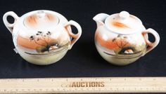 VINTAGE HAND PAINTED SCENIC COVERED CREAMER AND SUGAR BOWL SET. SIGNED TT MADE IN JAPAN. MEASURES 3.5 INCHES HIGH AND IS IN VERY GOOD VINTAGE CONDITION.
