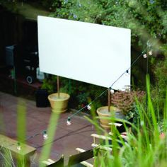 make a movie screen with a white board and two planters