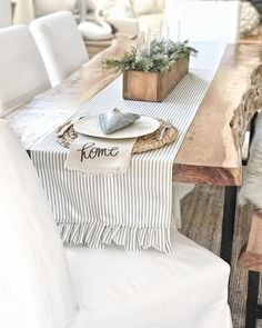 love this farmhouse style dining room tablescape. The ticking runner just sets it off!