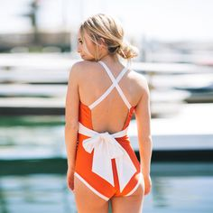 NEW! Say helloooo to the Sunset Blvd. A bright poppy slimming one-piece, with ivory straps and a sash that ties in the back. | #albionfit