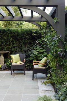 Make a vignette like this more intimate and private by adding an arbour overhead. Remember that backyards don't always have to be swathed in grass. Instead, create an inviting terrace like this one with a Pennsylvania bluestone floor. This way, plants and flowers take centre stage without competing with green grass. Also, choose simple patio furniture to keep a garden from looking too busy.