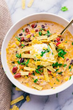 Creamy Chicken Tortilla Soup Crock Pot is full of flavor, easy to prepare and makes the house smell amazing. A perfect fall recipe & one that feeds a crowd. #soup #tortillasoup #chicken