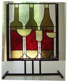 stained glass wine bottle and glasses in metal stand