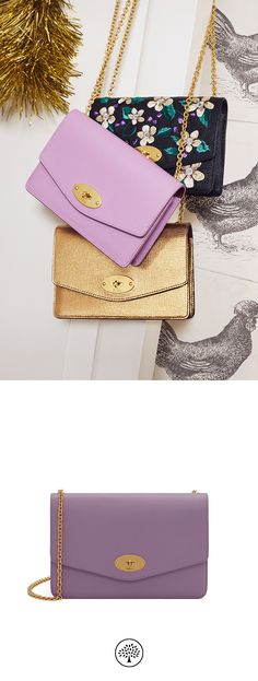 Shop the Small Darley in Lilac Leather at Mulberry.com. The Small Darley is iconic with the Mulberry signature Postman's Lock and is perfect for carrying essentials or used to keep valuables secure inside an everyday bag. It can be transformed into a mini bag thanks to its detachable chain strap.