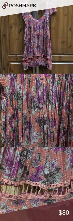 FREE PEOPLE TUNIC Great worn condition! Worn once! Material is naturally worn & frayed (as FP is known for). Beautiful top! Flowy body with cap sleeves. Free People Tops Blouses