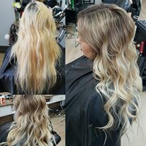 Ashy balayage finished with a beautiful wavy style. Dark brown dropped root to platinum blonde ends