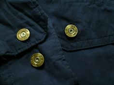 Misc Shirts and Buttons - Brass Button Works Photo Gallery. Need a gift for that special man in your life? What better way than to buy him a custom shirt with buttons made from bullet cartridges! Please check out the website www.brassbuttonworks.com for products and more information.