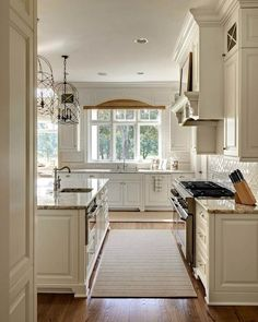 Light and bright kitchen. Specifics: cabinets are painted Benjamin Moore White Dove, granite white springs