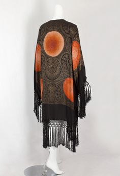 Metallic brocaded evening coat, circa 1925 | Made from metallic brocaded silk. The incandescent medallions are filled with ingenious, intricate floral motifs