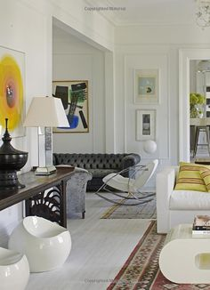 Great mix & pops of yellow , gray, plus oriental rug, in an all white interior!!