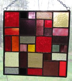 Stained Glass window panel two was created in the same fashion as number one using glass in shades of red, purple, black and grey with a hint of yellow.