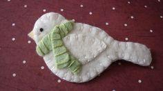 white felt bird with striped scarf ornament