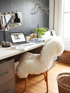 gray + fluffy white chair, pop of color with green, warm wood plus black accents faux on elements of style
