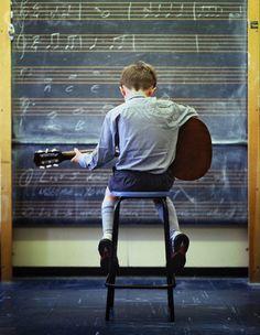 boy playing music