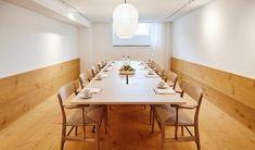 Wide wooden boards line the floors of a meeting room at Nobis Hotel Copenhagen.