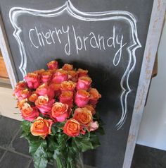 FLOWERS 101: Cherry Brandy Roses 'Cherry Brandy roses are loved for their bi-colored blooms that are bright fuchsia on the outside and sunny yellow on the inside.'