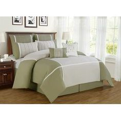 Green comforter set with two accent pillows.  Product: 1 Comforter2 Euro shams2 Standard shams2 Accent pillows1 BedskirtConstruction Material: Double brushed microfiberColor: GreenFeatures:  One gold sequined accent pillowOne embroidered accent pillowAccent pillows include inserts Note: Shams do not include inserts