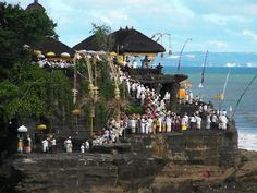 A local festival ceremony at Taneh Lot temple in Bali. For more photos & some of my Bali experiences, click the pic!