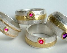 Selection of rings in sterling silver, 18 carat yellow gold, pink tourmaline, ruby, amethyst.