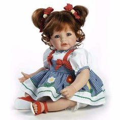 Auburn-red hair tied up in red and white polka-dot bows with sweet daisy adornments, truly brings out the vibrancy of her pretty blue eyes. Ready for a morning of play at the park in her navy and white gingham dress adorned with multicolored daisy and red Baby Dolls For Kids, Baby Girl Dolls, Toddler Dolls, Toddler Girl, Toddler Play, Child Doll, Kids Toys, Marie Osmond, Reborn Dolls