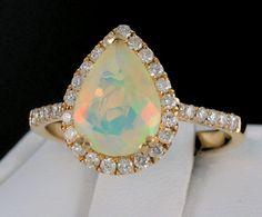 Genuine Ethiopian Opal and Diamond Halo Ring. Halo Rings, Halo Diamond, Gemstone Jewelry, Birthstones, Heart Ring, Fine Jewelry, Diamonds, Pendants, Boutique