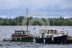 Two Finnish pleasure motor boats in the water area of ​​the port of Kotka. Time of the regatta THE TALL SHIPS RASES Kotka 2017. Kotka, Finland