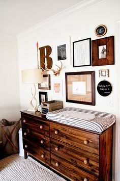 Oh this is a lovely woodland theme for your nursery. Love the changing station on top of the dresser. Some elements would fit for a rustic decor too!