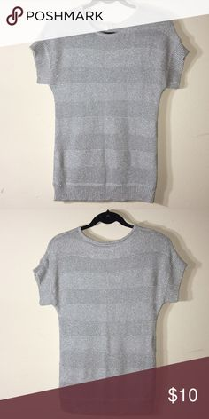 Metallic short sleeve sweater Made from 60% viscose, 26% polyester, 14% metallic. Make me an offer OR when you bundle 3 or more items from my closet you only pay shipping ONCE, you get 15% OFF, and a FREE JEWELRY RELATED GIFT!!! Sweaters