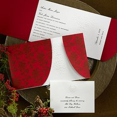 Red wedding invitations - love how the embossing peeks through the red.