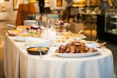 Buffet tables were also set up throughout the three floors of venue with Southern fare such as cheddar cheese grits, barbecue beef brisket, and cornbread served in iron skillets.
