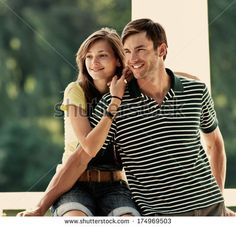 Portrait of a happy couple of young people in the park summer day - stock photo