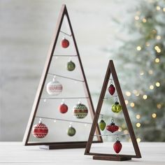 DIY ornament display tree -- crate and barrel knock off -- large and small plans - can also use to hang pictures rest of winter Wooden Christmas Trees, Beautiful Christmas Trees, Modern Christmas, Christmas Home, Christmas Tree Decorations, Christmas Tree Ornaments, Christmas Crafts, Christmas Ideas, Ornaments Ideas