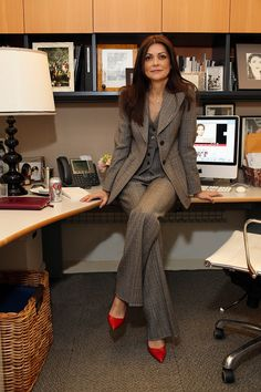 Marc Jacobs three-piece plaid suit Manolo Blahnik red pumps  The minute I saw this look go down the runway, I knew I had to have it. It is just one of those classic pieces that makes me feel instantly put together—and I don't have to give it much thought.