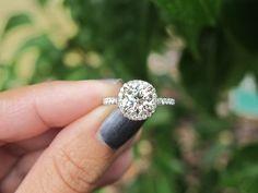 Engagement Ring Round Cut-- I really like this look of halfway between perfect circular cut and a princess/cushion cut!
