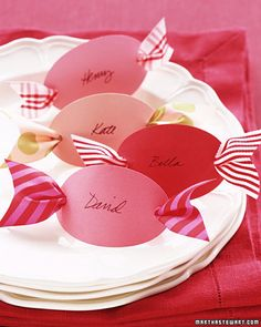 Peppermint-Candy Place Cards  What could be sweeter? Cut out 3-inch ovals from colorful card stock. Using a hole punch, make a hole at each end, and then neatly write your guests' names on the ovals with black ink. Thread ribbon scraps, each about 6 inches long and 1 1/2 inches wide, through the backs of the place cards. Notch the ribbon ends, and set a card at each place setting.