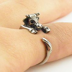 This silver calf / cow ring is slightly adjustable with a gentle squeeze. It fits a size 5-9. He is sweet with Swarovski Crystal eyes, big ears and spots as this little guy wraps around your finger, t