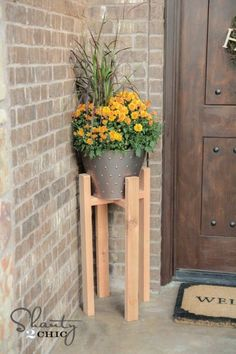 Let the girls from Shanty 2 Chic show you how to build your own plant stands to from your front door! || @shanty2chic