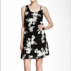 Daniel rainn black and white floral dress Beautiful polyester dress with no sleeves and snitches in at the waist! Wore once on Easter! Love it! Daniel Rainn Dresses