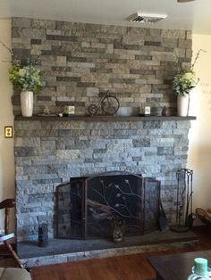 Air stone fireplace. Easier than real stone and looks great. You can place right on top of your old brick, stone.. Etc.