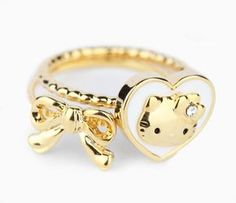 This set contains 2 petite Hello Kitty rings with goldtone hearts and bows. Wear these fine designs as knuckle rings, pinky rings or the usual way. Stack together or separate for an adorable effect. Part of the Hello Kitty Big Heart collection - look out for the matching pieces! Designed for Ages 13 and up.